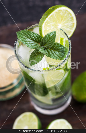 Mojito Drink on Wooden Table stock photo, Mojito Lime Drink Cocktail on Wooden Table from Above by Karol Czinege
