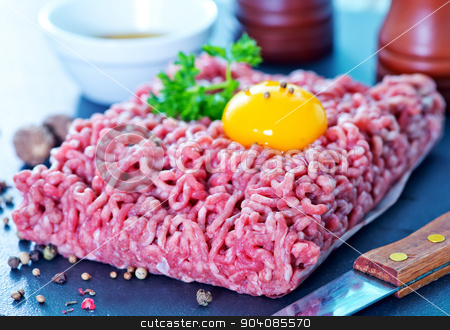 minced meat stock photo, minced meat with spice and raw egg on a table by tycoon