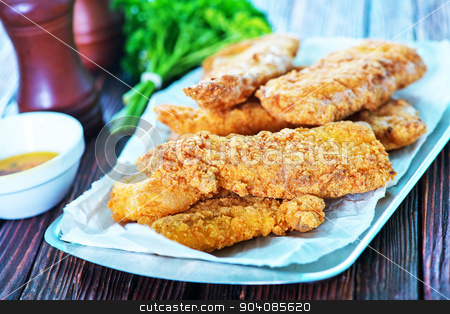fried fish stock photo, fried fish on tray and on a table by tycoon