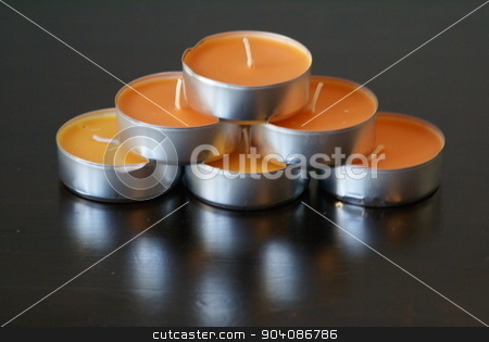 set of scented mango candles in metal cups stock photo, set of new candles by Saphire Ovadia