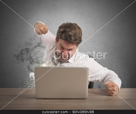 Stressed and overworked businessman stock photo, Stressed businessman breaks the computer with punch by Federico Caputo