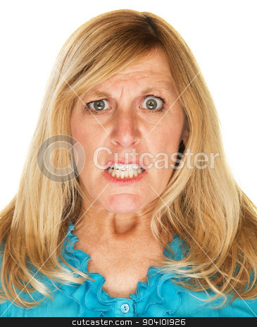 Mad Woman Scowling stock photo, Single mad scowling blond female over white by Scott Griessel
