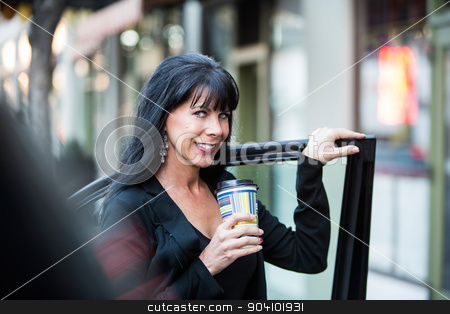 Woman Near Car with Coffee stock photo, Beautiful mature business woman with coffee near her car in urban setting by Scott Griessel