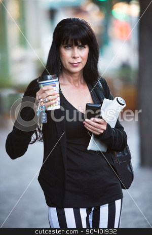 Business Woman Prepared for Her Day stock photo, Attractive business woman in downtown setting with work and personal accessories by Scott Griessel