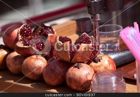 Pomegranates on Table stock photo, Split pomegranates ready to be juiced on Turkish street vendor table by Scott Griessel