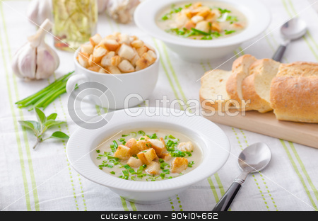 Garlic soup with croutons, spring onions and chives stock photo, Garlic soup - bio garlic, red onion, all natural ingredients, eat clean by Peteer