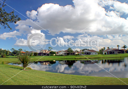 Lake stock photo, A lake in a residential area with reflections by Lucy Clark