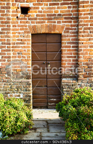 italy  lombardy     in  the milano old   church  bush   pavemen stock photo, door italy  lombardy     in  the milano old   church   closed brick     pavement by mason luca