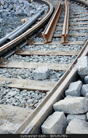 Tram track stock photo, Repairing tram track, stone blocks and pipes. by richpav
