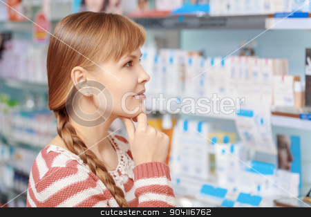 Customer choice at the pharmacy stock photo, Wide range of beauty products. Young attractive woman looking at the shelves with medications at the pharmacy by Viacheslav Iakobchuk