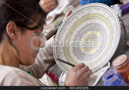 Woman Adding Color to Turkish Ceramic Bowl stock photo, CAPPADOCIA, TURKEY – APRIL 17: Artist adds detail to a ceramic bowl with animal design patternon April 17, 2012 in Cappadocia, Turkey. by Scott Griessel