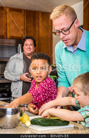 Dads in Kitchen stock photo, Two dads in kitchen cook with children by Scott Griessel