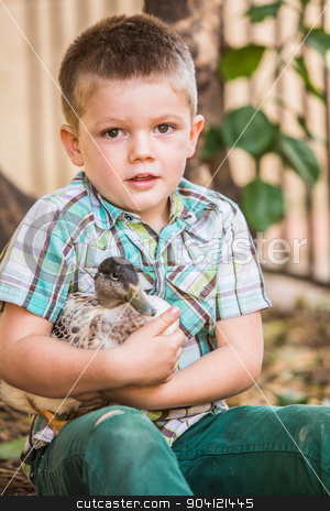 Pet Duck and Little Boy stock photo, Cute child in green holding his pet duck by Scott Griessel