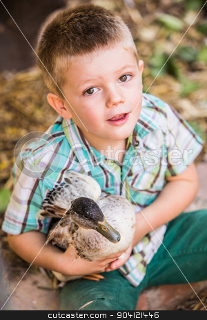 Cute Boy Holding a Duck stock photo, Cute Caucasian male child with duck his pet duck by Scott Griessel