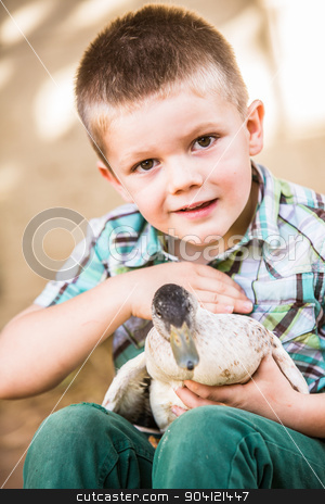 Happy Child Petting Duck stock photo, Happy child petting a duck in his lap by Scott Griessel