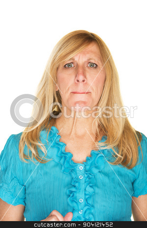 Confused Woman in Blue stock photo, Confused middle aged Caucasian female over white background by Scott Griessel