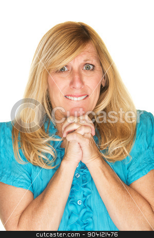 Wishful Woman Praying stock photo, Wishful single woman with clasped hands over white background by Scott Griessel