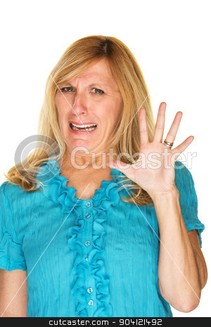 Disgusted Woman with Shocked Expression stock photo, Disgusted woman in blue holding hand up by Scott Griessel