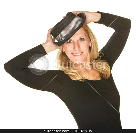 Cute Woman Posing with Hat stock photo, Beautiful blond woman dancing and holding hat by Scott Griessel