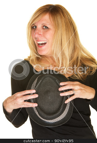 Joyful Singer Holding Hat stock photo, Beautiful middle aged singer holding black hat by Scott Griessel