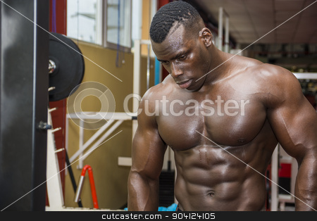 Hunky muscular black bodybuilder working out in gym stock photo, Hunky muscular black bodybuilder working out in gym, resting after exercise by Stefano Cavoretto