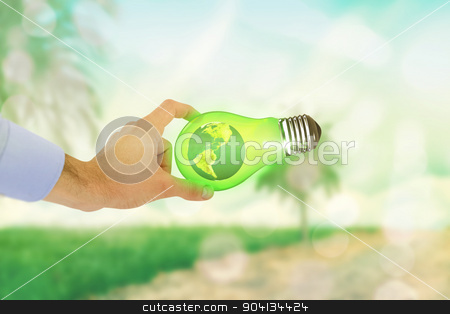Composite image of businessman holding hand out in presentation stock photo, Businessman holding hand out in presentation against light circles on green background by Wavebreak Media