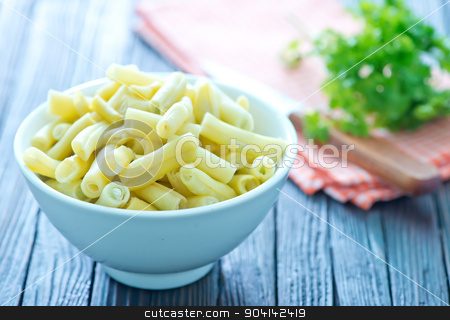 pickled beans stock photo, beans in bowl and on a table by tycoon