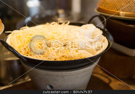 bowl of rice noodles garnish at asian restaurant stock photo, cooking, kitchen and food concept - bowl of rice noodles garnish at asian restaurant by Syda Productions