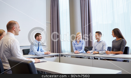 group of smiling businesspeople meeting in office stock photo, business, people and teamwork concept - group of smiling businesspeople meeting in office by Syda Productions