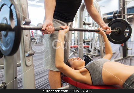 man and woman with barbell flexing muscles in gym stock photo, sport, fitness, teamwork, weightlifting and people concept - young woman and personal trainer with barbell flexing muscles in gym by Syda Productions