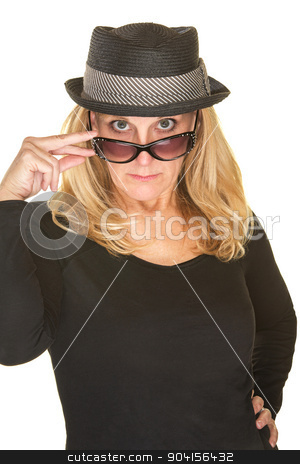 Lady Looking Over Sunglasses stock photo, Cute woman in black with hat looking over sunglasses by Scott Griessel