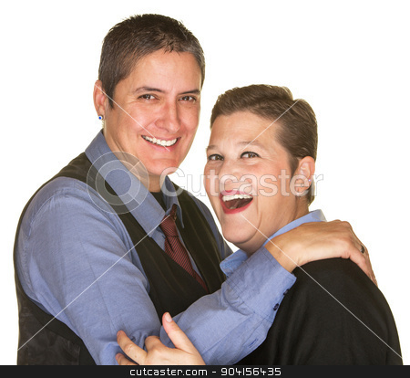 Joking Woman with Butch Partner stock photo, Joking lesbian couple in blue shirts on isolated background by Scott Griessel
