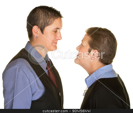Boyish Couple Staring at Each Other stock photo, Isolated boyish female couple staring at each other by Scott Griessel