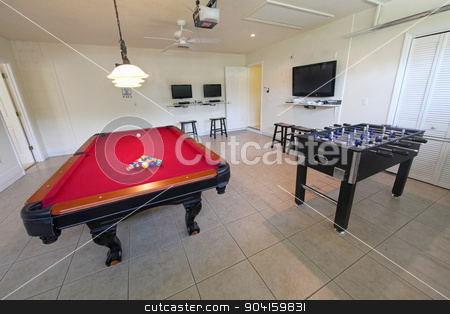 Games Room stock photo, A games room with pool table and foosball by Lucy Clark