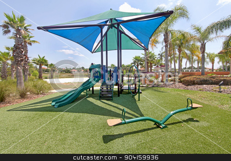 Playground stock photo, A playground with slides and a seesaw by Lucy Clark