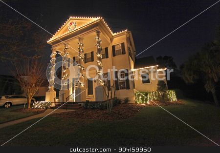 Christmas Lights stock photo, A Colonial House with a lot of Christmas Lights by Lucy Clark