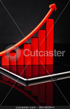 Computer tablet with financial graph stock photo, Computer tablet with financial graph by Sebastian Duda