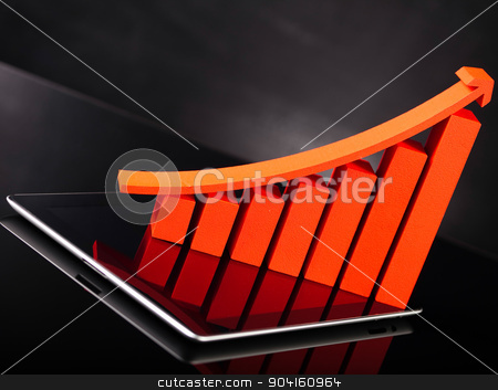 Financial graph on tablet with calculator stock photo, Financial graph on tablet with calculator by Sebastian Duda