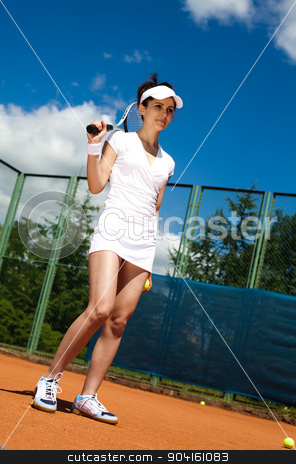 Girl playing tennis on the court stock photo, Girl playing tennis on the court by Sebastian Duda