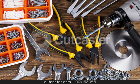 Set of different tools on wooden background stock photo, Set of different tools on wooden background by Sebastian Duda