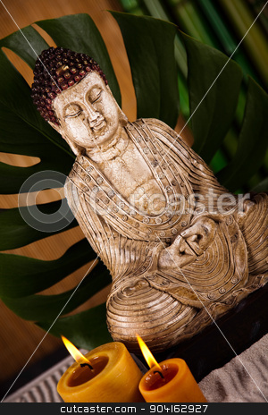 Buddha statue with orchid flower stock photo, Buddha statue with orchid flower by Sebastian Duda