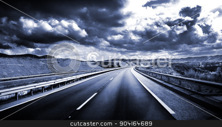 Road scenery. stock photo, Road scenery. Travel concept.Cloudy sky and high road in blue toned  by carloscastilla