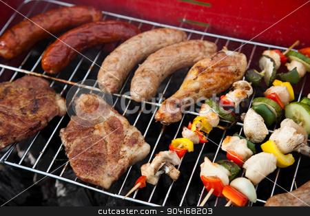 Grilling meat in flames, tasty dinner  stock photo, Grilling meat in flames, tasty dinner by Sebastian Duda