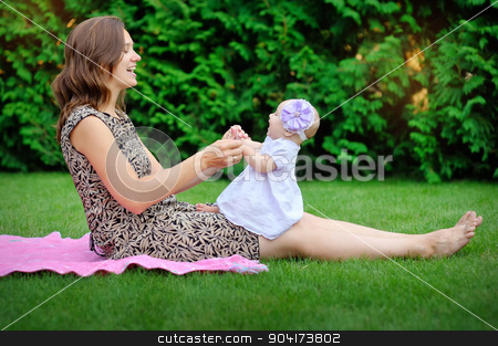 Beautiful Mother And Baby outdoors. Nature. Beauty Mum and her C stock photo, Beautiful Mother And Baby outdoors. Nature. Beauty Mum and her Child playing in Park together. Outdoor Portrait of happy family. Joy. Mom and Baby  by timonko