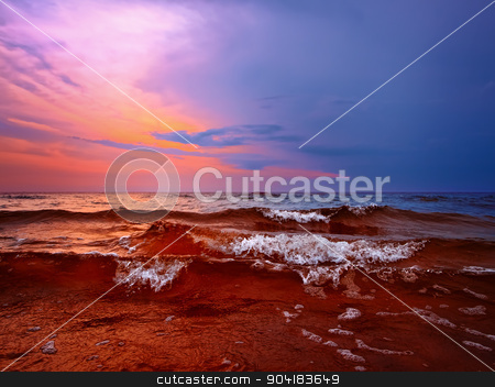 sunset at the sea stock photo, Bright sunset above the wavy sea by Sergej Razvodovskij