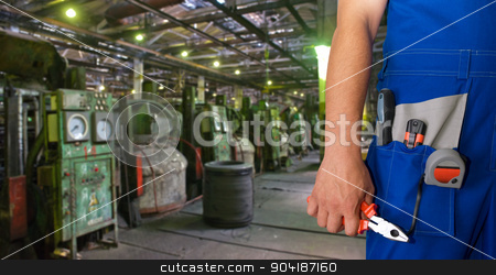 Worker  stock photo, Worker with instruments at industrial factory by olinchuk