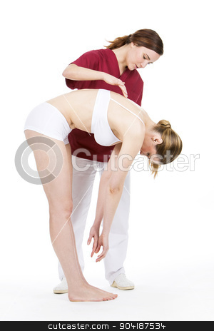 physiotherapist doing a physical examination stock photo, physiotherapist doing a physical examination of a woman by Flareimage