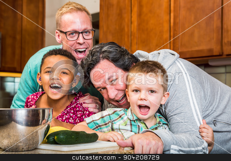 Family Cooking Together stock photo, Smiling gay parents with their children in the kitchen by Scott Griessel