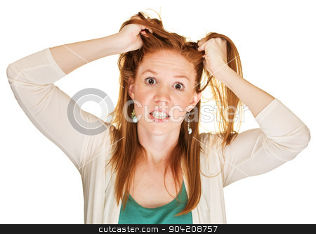Angry Woman Pulling Her Hair stock photo, Isolated beautiful young Caucasian female with red hair by Scott Griessel