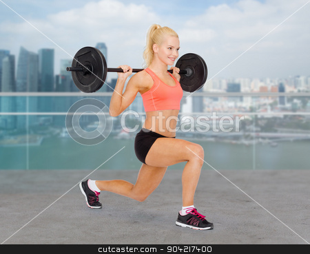 sporty woman exercising with barbell stock photo, fitness, sport, weightlifting and people concept - sporty woman exercising with barbell over city waterside background by Syda Productions